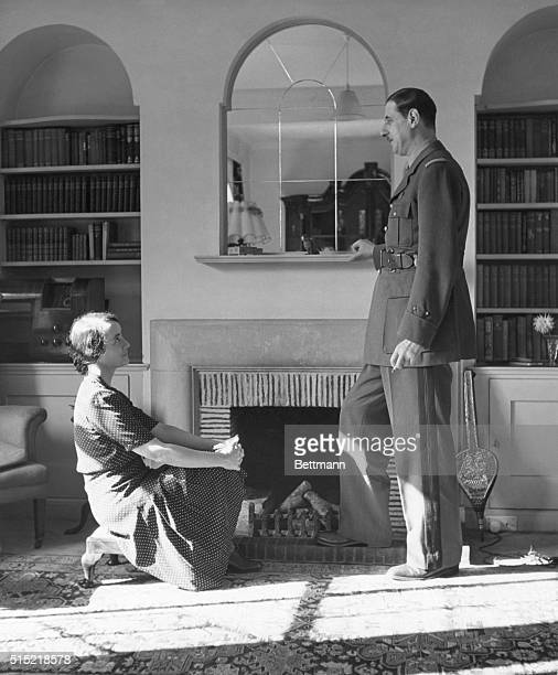 General Charles de Gaulle in conversation with wife Yvonne in the couple's home library