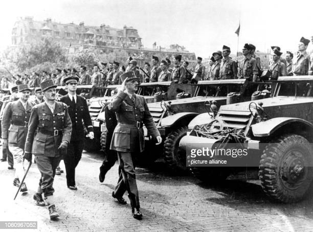 General Charles de Gaulle inspects a motorised division near the Arc de Triomphe after the entry to Paris on the 26th of August in 1944 German...