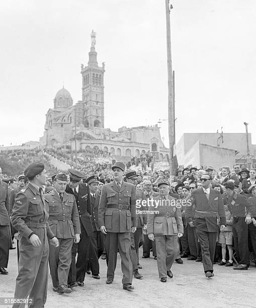 General Charles De Gaulle is greeted by a crowd of onlookers as he leaves the Basilica of Notre Dame de la Garde in Marseille France after attending...