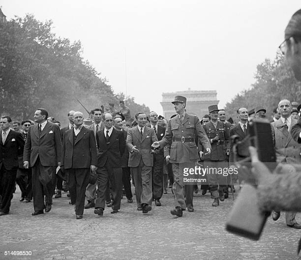 General Charles de Gaulle leads a triumphant procession down ChampsElysees as part of the celebration of the liberation of Paris To the right of de...