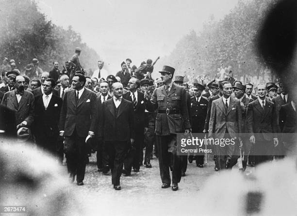 General Charles De Gaulle tours Paris with the triumphant Resistance workers during the Liberation of Paris.