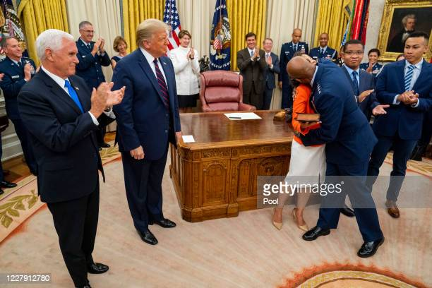 General Charles Q Brown embraces family members after being sworn in as the incoming Chief of Staff of the Air Force as US President Donald Trump and...
