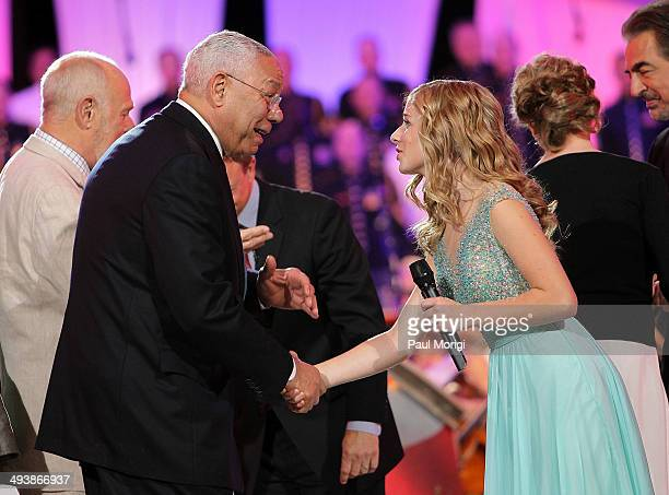 General Colin Powell shakes hands with Jackie Evancho during the 25th National Memorial Day Concert finale at the US Capitol West Lawn on May 25 2014...