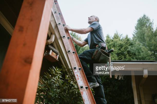 general contractor installing new roof - roof stock photos and pictures