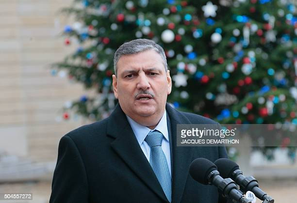 General Coordinator of the High Negotiations Committee for the Syrian Revolution and Opposition Forces Riad Hijab makes a statement after a meeting...