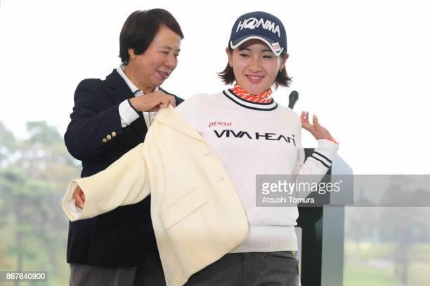 General Counsel Hisako Higuchi giving Kana Nagai of Japan wearing blazer during jacket ceremony after winning the Higuchi Hisako Ponta Ladies at the...