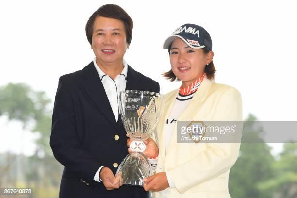 General Counsel Hisako Higuchi of Japan and Kana Nagai of Japan pose with the trophy during award ceremony of the Higuchi Hisako Ponta Ladies at the...