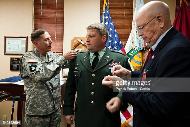 General David Howell Petraeus the 10th and current Commander of the US Central Command promotes Erik O Gunhus to the rank of colonel in Petraeus's...