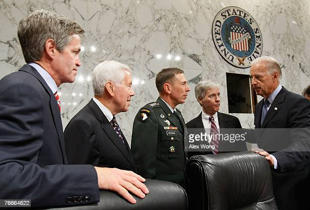 General David Petraeus and US Ambassador to Iraq Ryan Crocker greet Sen Joe Biden Chairman of the Senate Foreign Relations Committee and Sen Norm...