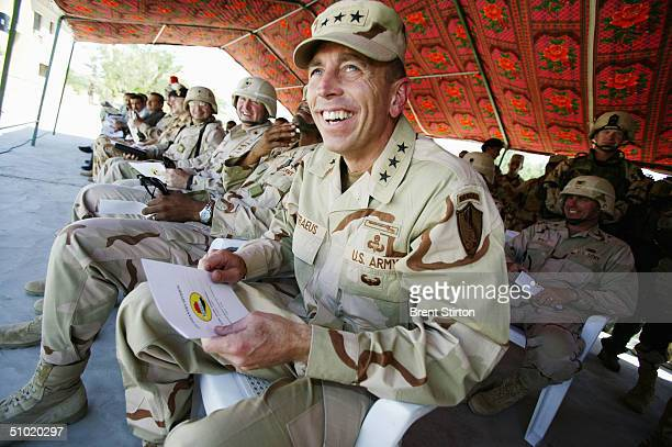 General David Petraeus the threestar American general charged with overseeing the transition of power from the Coalition military authorities to the...