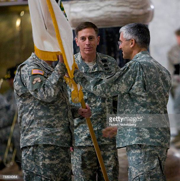General David Petraeus watches Gen John Abizaid the outgoing Central Command chief take the flag from Gen George Casey as Petraeus becomes US...