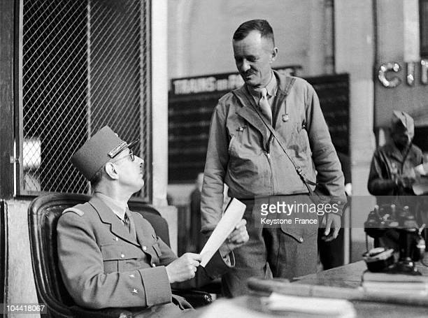 General DE GAULLE after his arrival in Paris reads the capitulation act agreed to by the commander of the German forces VON CHOLTITZ who was...