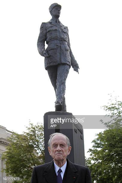 General de Gaulle' son Philippe de Gaulle poses in front of a statue depicting his father on June 18 2010 during a ceremony in Paris as part of the...