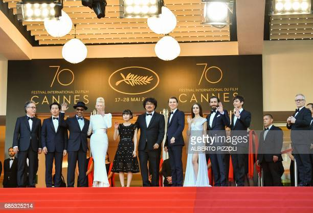General Delegate of the Cannes Film Festival Thierry Fremaux greets Canadian actor Devon Bostick US actor Jake Gyllenhaal British actress Lily...