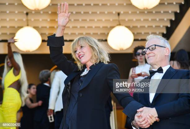 General Delegate of the Cannes Film Festival Thierry Fremaux holds the hand of US actress and President of the Un Certain Regard jury Uma Thurman as...