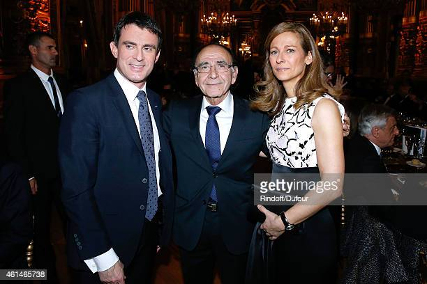 General delegate of Weizmann Institute Robert Parienti standing between French Prime Minister Manuel Valls and his wife violonist Anne gravoin attend...