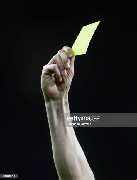 General detail of a Referee holding up a Yellow Card during the UEFA Champions League Round of Sixteen Second Leg match between Manchester United and...