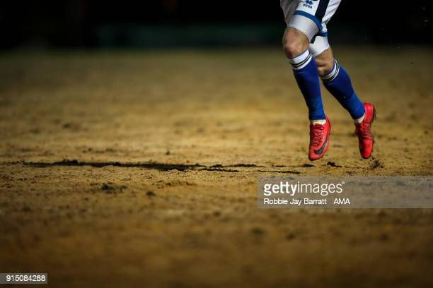A general detail view of a pair of Nike football boots running across the sand on the pitch at Spotland home stadium of Rochdale during The Emirates...