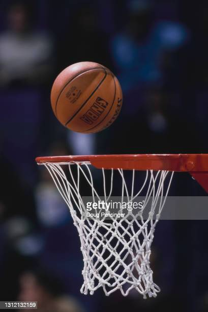 General detail view of a Spalding basketball dropping into the hoop to score during the NBA Atlantic Division basketball game between the Washington...