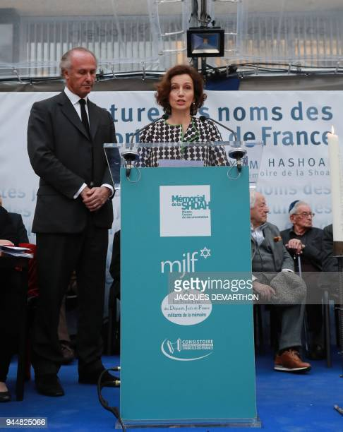General Director Audrey Azoulay reads out names of World War II deported jews flanked by Shoah Memorial vicepresident Francois Heilbronn during a...