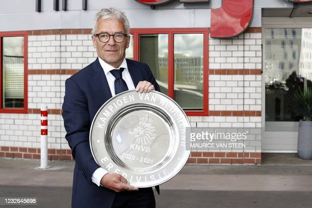 General director Eric Gudde poses with the Dutch Eredivisie trophy dish prior to the Dutch Eredivisie football match between Ajax Amsterdam and FC...