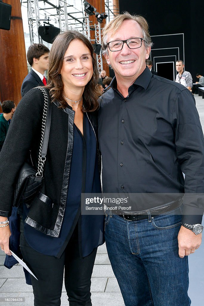 General director of Chanel Bruno Pavlovsky (R) and his wife attend Maxime Simoens show as part of the Paris Fashion Week Womenswear Spring/Summer 2014, held at Orangerie du parc Andre Citroen on September 29, 2013 in Paris, France.
