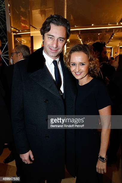 General Director of Facebook France Laurent Solly and his wife journalist Caroline Roux attends the Longchamp Elysees Lights On Party Boutique Launch...
