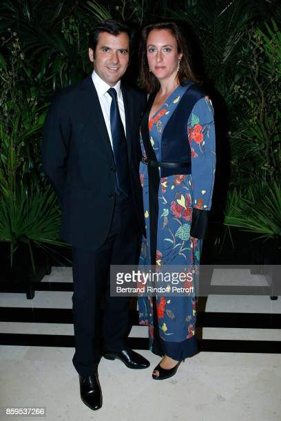 General Director of Galeries Lafayette Nicolas Houze and his wife AnneCharlotte attend the Diner des Amis de Care at Hotel Peninsula Paris on October...