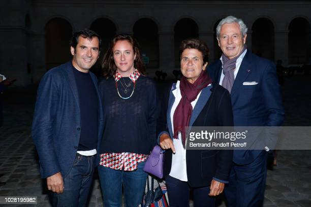General Director of Galeries Lafayette Nicolas Houze his wife AnneCharlotte Chairman of the Board of Galeries Lafayette Group Philippe Houze and his...