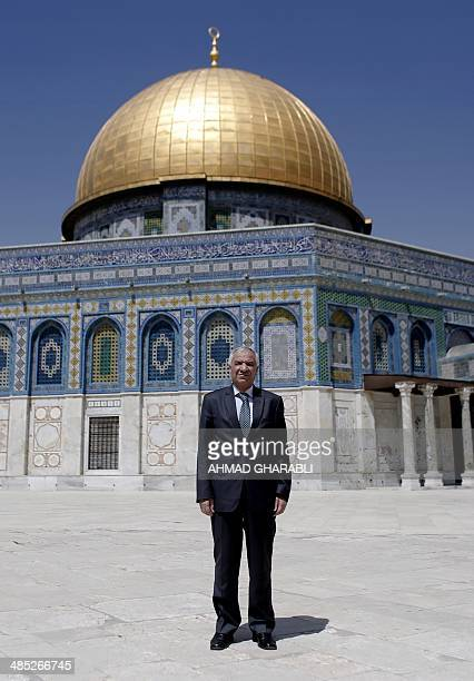 General Director of Muslim Endowments and AlAqsa Mosque Azzam alKhatib poses in front of the Dome of the Rock in the AlAqsa Mosque compound in the...