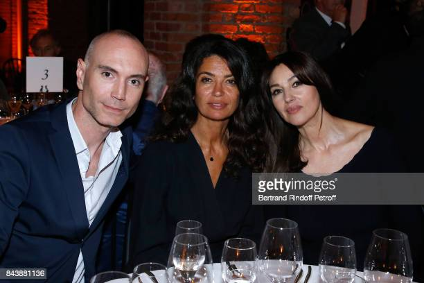 General Director of Publicis Jerome Batout Afef Jnifen and actress Monica Bellucci attend the 'Richard Wentworth a la Maison Alaia' Exhibition...