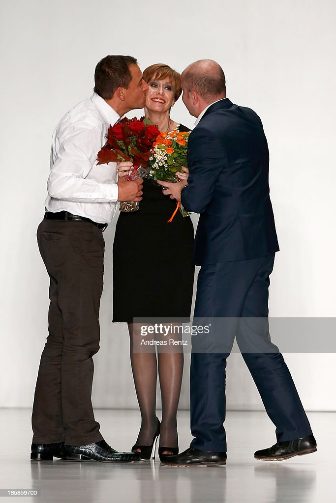 General Director of Sudar Svetlana Stepanova (C) receives flowers following the 'Sudar' PLC, TM 'VENZANO' Styled By 'Leonid Alexeev' show during the Mercedes-Benz Fashion Week Russia S/S 2014 on October 25, 2013 in Moscow, Russia.