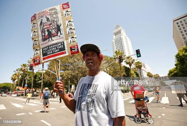 General Dogon from Los Angeles Community Action Network joins protestors that briefly shut down the intersection of Main and 1st Streets in downtown...
