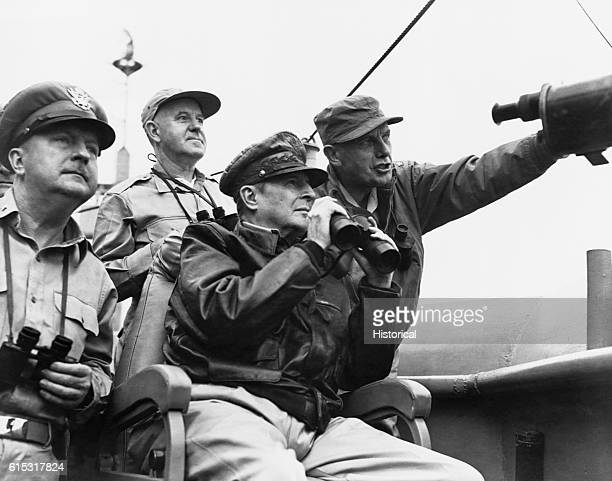 General Douglas MacArthur General Whitney and General Almond observe the progress of shelling the enemy before the landing at Inchon | Location Near...