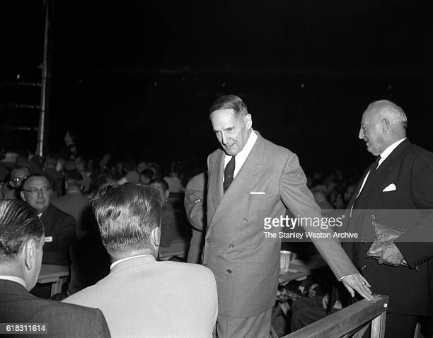General Douglas MacArthur is one of the many spectators at the Carmen Basilio vs Sugar Ray Robinson middleweight title fight in Bronx New York...