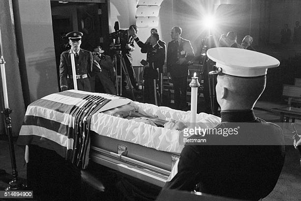 General Douglas MacArthur lies in an open casket surrounded by a military honor guard