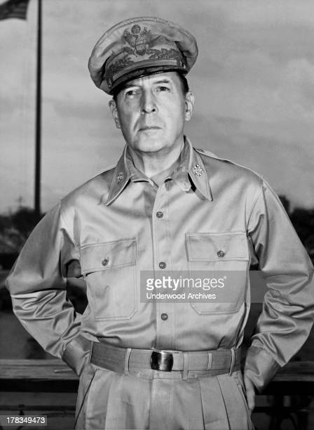 General Douglas MacArthur on the veranda of his office in Manila shortly before he left for Tokyo after Japan had surrendered two weeks previously...