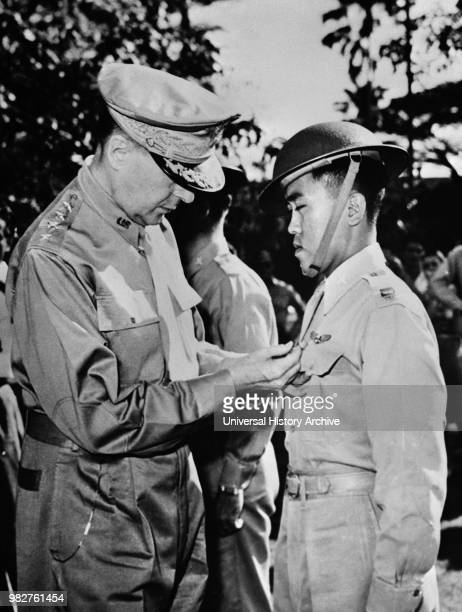 US General Douglas MacArthur Pinning Distinguished Service Cross on Captain Jesus A Villamor of the Philippine Air Force for Heroism in the Air...
