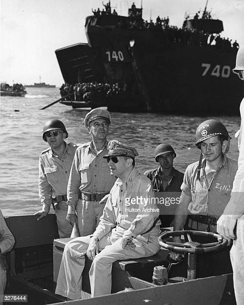 General Douglas MacArthur returning to liberate the Philippines from the Japanese invaders during WW2 He was Commander in Chief of the South West...
