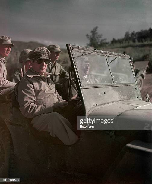 General Douglas MacArthur rides in a Jeep near the front in Seoul during the Korean War