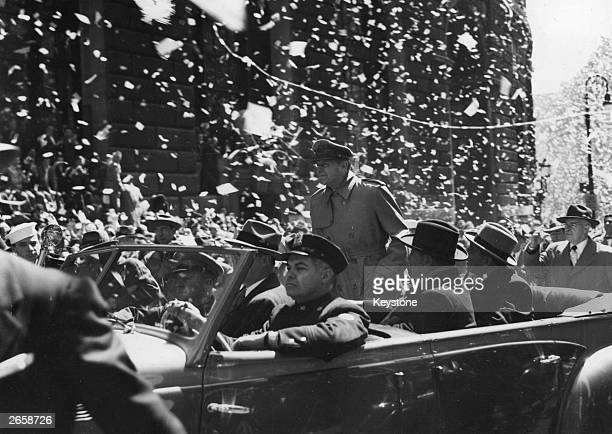 General Douglas MacArthur riding down Broadway New York during his official welcome to the city having been relieved of his Asia commands by...