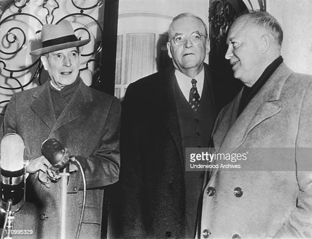 General Douglas MacArthur, Secretary of State to be, John Foster Dulles, and President-elect Dwight Eisenhower stand outside of Dulles' home after...