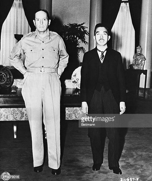 General Douglas MacArthur stands next to Japanese Emperor Hirohito in the US Embassy in Tokyo. General MacArthur became responsible for supervising...