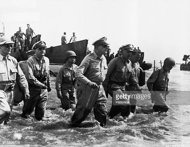 General Douglas MacArthur wades ashore during initial landings at Leyte Island Philippines on October 20 1944 MacArthur had retreated swiftly from...