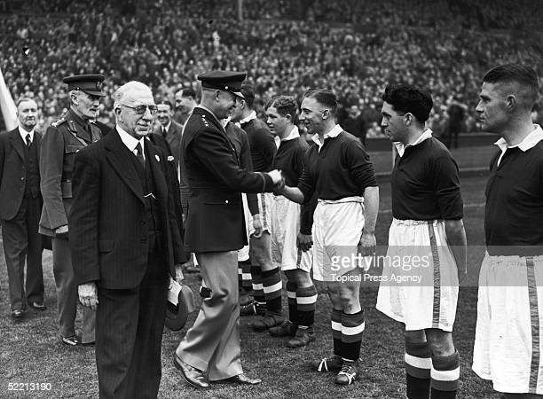 General Dwight D Eisenhower meeting the Chelsea team before the South Cup Final between Charlton Athletic and Chelsea at Wembley Stadium 17th April...