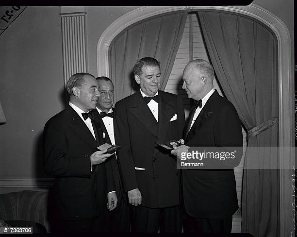 General Dwight D Eisenhower presents to Richard Rodgers and Oscar Hammerstein the Gold Medal of the One Hundred Year Association at its annual dinner...