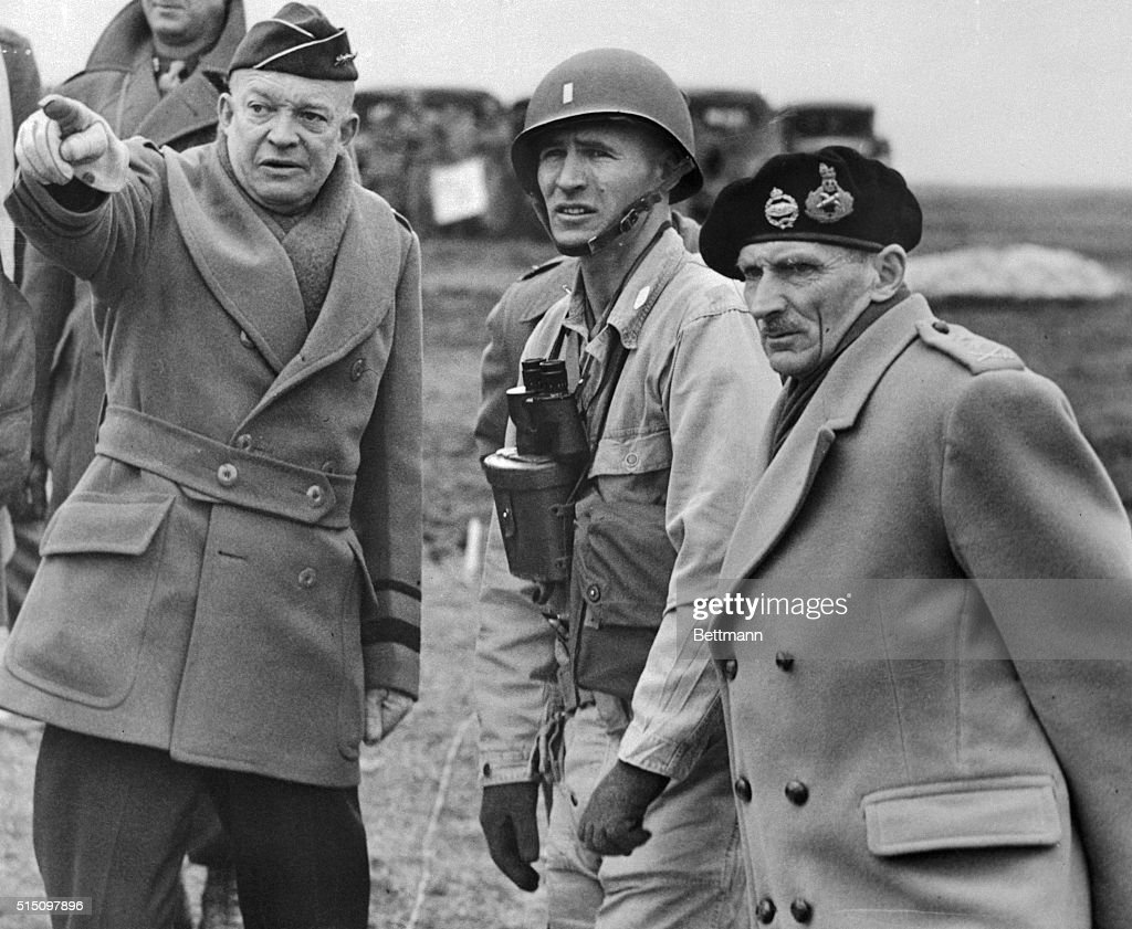 General Dwight D. Eisenhower (left) shows the strain of his command in his expression as he and Britain's Field Marshall Bernard Montgomery (right), his deputy commander, confer on invasion plans of Normandy. General Eisenhower had the agonizing task of deciding when to invade Europe.