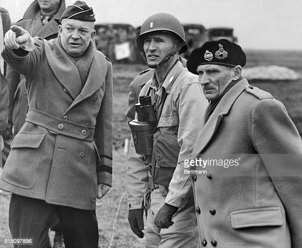 General Dwight D Eisenhower shows the strain of his command in his expression as he and Britain's Field Marshall Bernard Montgomery his deputy...