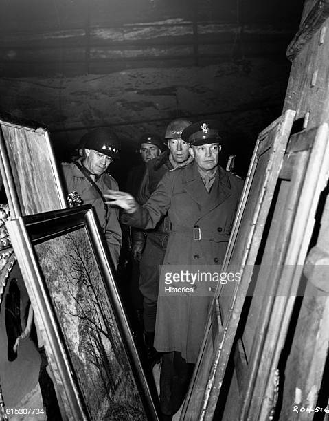 General Dwight D. Eisenhower, Supreme Allied Commander, accompanied by General Omar N. Bradley, and Lt. General George S. Patton, Jr., inspects...