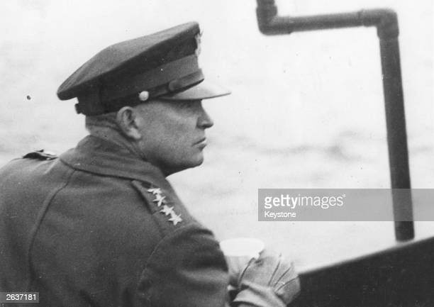 General Dwight D Eisenhower Supreme Commander of the Allied Forces watches the Allied landing operations from the deck of a warship in the English...